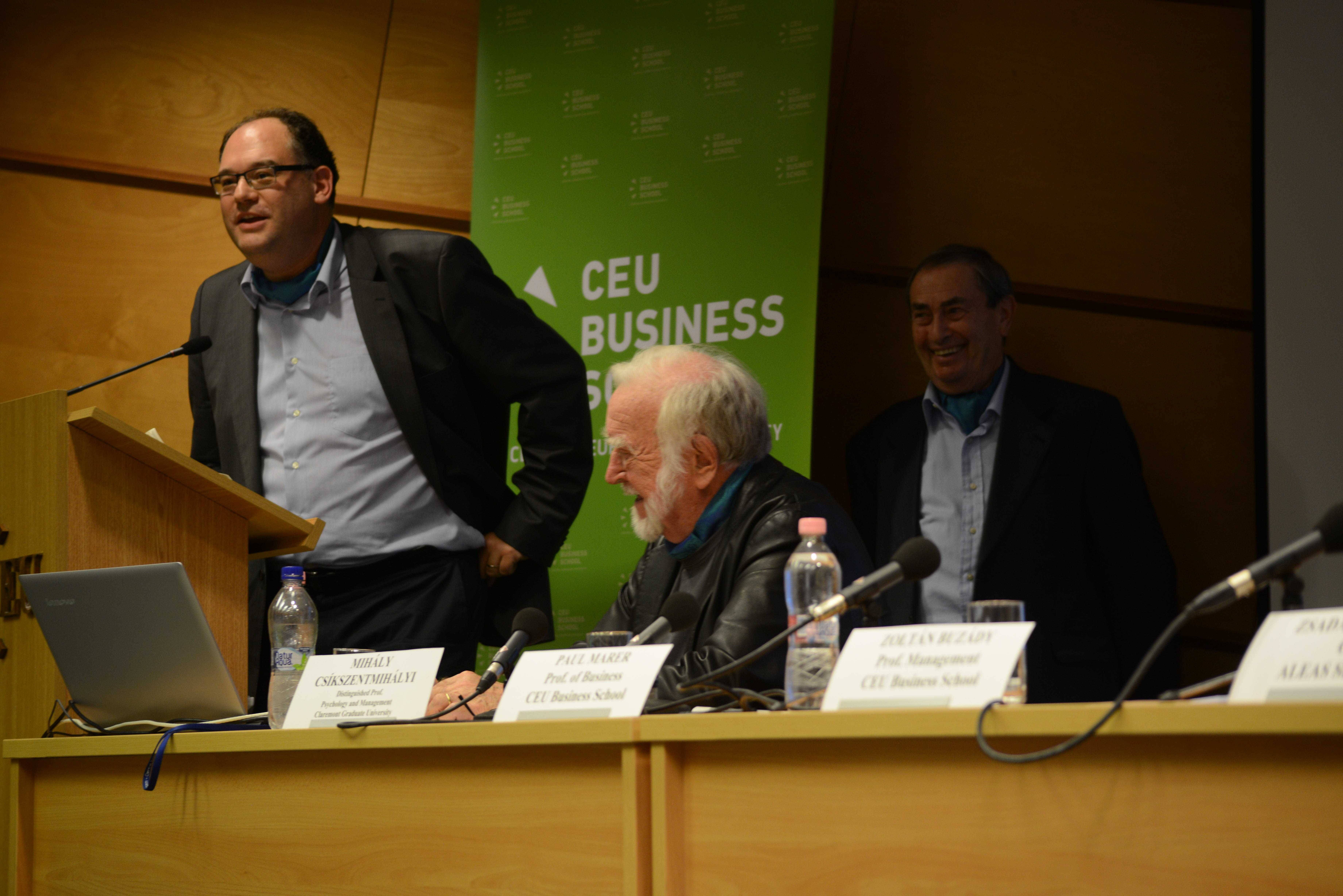 Zoltan Buzady, faculty member at CEU Business School, with Mihalyi Csikszentmihalyi and Professor Paul Marer (background) of CEU Business School. Photo: Edina Ligeti.