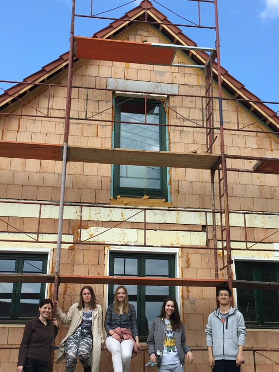 CEU students help build a community house in rural Hungary.